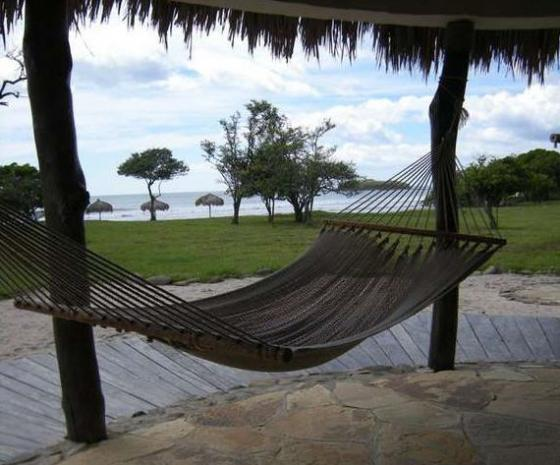 A guest bungalow's hammock sways in the ocean breeze at Punta Teonoste Nature Lodge & Beach Spa on Nicaragua's Pacific coast.