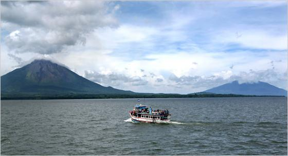 "In 1866, Mark Twain described the volcanoes on Ometepe Island, Nicaragua, as ""two magnificent pyramids, clad in the softest and richest green, all flecked with shadow and sunshine."""