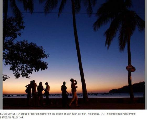 Some Sunset: A group of tourists gather on the beach of San Juan del Sur, Nicaragua. (photo: Esteban Felix)
