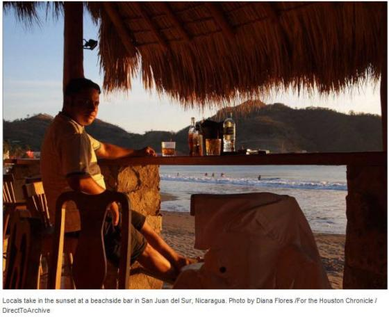 Locals take in the sunset at a beachside bar in San Juan del Sur, Nicaragua. (photo: Diana Flores)