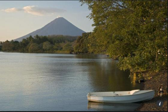boat on Lago de Nicaragua with Volcano in the background (photo: Margie Politzer)