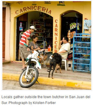 locals gather outside the local butcher in San Juan Del Sur. Photo: Kristin Fortier