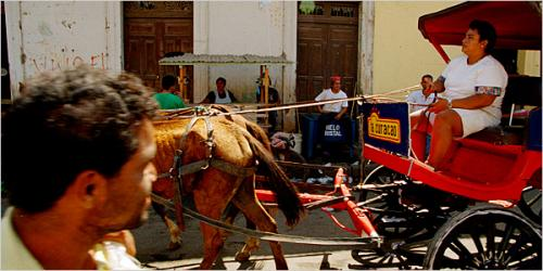 Lonnie Schlein/The New York Times - A horse-drawn taxi, a common form of urban transit in Granada, an increasingly popular destination for the tourists Nicaragua is seeking.